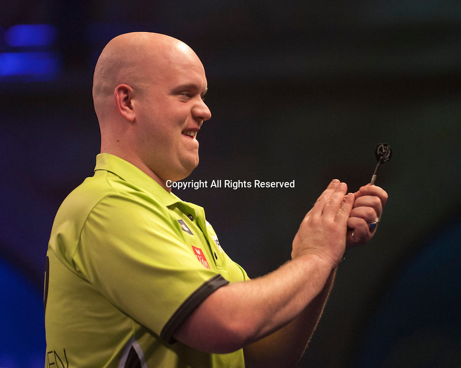 01.01.2014.  London, England.  William Hill PDC World Darts Championship.  Quarter Final Round.  Michael van Gerwen (1) [NED] applauds the crowd after a 170 finish to win the match against Robert Thornton (9) [SCO]. Michael van Gerwen won the match 5-2