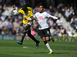 Derby Tom Ince Battles with Brentford Toumani Diagouraga, Derby County v Brentford, Sy Bet Championship, IPro Stadium, Saturday 11th April 2015. Score 1-1,  (Bent 92) (Pritchard 28)<br /> Att 30,050