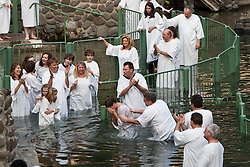 People get baptised at Yardentit, the Baptismal Site on the Jordan River, near the Sea of Galilee. Sunday 2nd Jan, 2011. Day three visit to a kibbutz. Train & Travel is a unique ten day program designed for IKMF's instructors, students & guests, interested in combining Krav Maga training with a tour of the holy land. .©2011 Michael Schofield. All Rights Reserved.