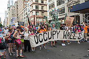 Occupy Wall Street carries its banner in the march.