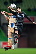 Melbourne City forward Bruno Fornaroli (23) winning the ball against Newcastle Jets midfielder Steven Urgakovic (6) at the FFA Cup Round 16 soccer match between Melbourne City FC v Newcastle Jets at AAMI Park in Melbourne.