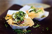 Salt-cured lamb tagine, smoked potato, fig, eggplant, lebneh, wildflower salad from Mezze Restaurant.