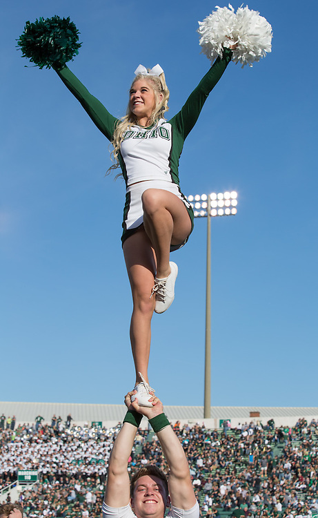 Siblings Chase and Nikki Worcester, who are on Ohio University's cheerleading squad, perform a trick during Ohio University's Homecoming football game on October 10, 2015 at Peden Stadium. Photo by Emily Matthews
