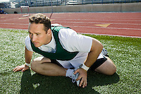 Male athlete stretching