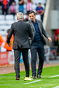 Sunderland AFC manager, Jack Ross shakes hands with Manager of Portsmouth FC, Kenny Jackett at the final whistle of the EFL Sky Bet League 1 match between Sunderland and Portsmouth at the Stadium Of Light, Sunderland, England on 17 August 2019.