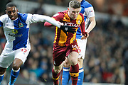 Bradford City striker Shay McCartan (14) and Blackburn Rovers defender Amari'i Bell (17) during the EFL Sky Bet League 1 match between Blackburn Rovers and Bradford City at Ewood Park, Blackburn, England on 29 March 2018. Picture by Craig Galloway.