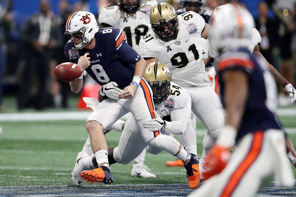Auburn Tigers quarterback Jarrett Stidham (8) fumbles the ball during the 2018 Chick-fil-A Peach Bowl NCAA football game against the UCF Knights on Monday, January 1, 2018 in Atlanta. (Jason Parkhurst / Abell Images for the Chick-fil-A Peach Bowl)