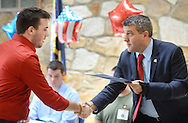 Bartholomew J. Masciulli is handed a proclamation from US Rep. Harry Frank during an Armed Services Commitment Ceremony for graduating seniors who have committed to pursue a career in the military Thursday May 26, 2016 at Neshaminy High School in Langhorne, Pennsylvania. (Photo by William Thomas Cain)
