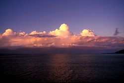 Thunderheads tower over an approaching storm front, reflecting the late afternoon sun on the Sea of Cortez, Baja California.