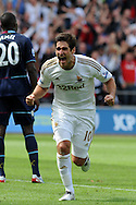 Swansea city's Danny Graham celebrates after he scores his sides 3rd goal. Barclays Premier league, Swansea city  v West Ham Utd at the Liberty Stadium in Swansea, South Wales  on Saturday 25th August 2012. pic by Andrew Orchard, Andrew Orchard sports photography,