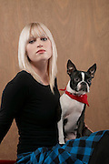 Young woman with French Bulldog on lap