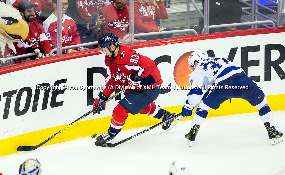 WASHINGTON, DC - MAY 21: Washington Capitals mascot Slapshot has a close up view as Washington Capitals center Jay Beagle (83) moves the puck along the boards away from Tampa Bay Lightning center Yanni Gourde (37) during game 6 of the NHL Eastern Conference  Finals between the Washington Capitals and the Tampa Bay Lightning, on May 21, 2018, at Capital One Arena, in Washington D.C. The Caps defeated the Lightning 3-0<br /> (Photo by Tony Quinn/Icon Sportswire)
