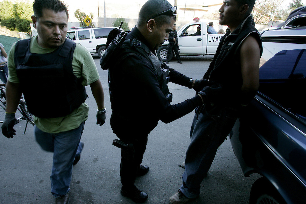 Tijuana Police agents search residents for illegal contraband during a drug sweep in Colonia Chula Vista  in Tijuana, Mexico.