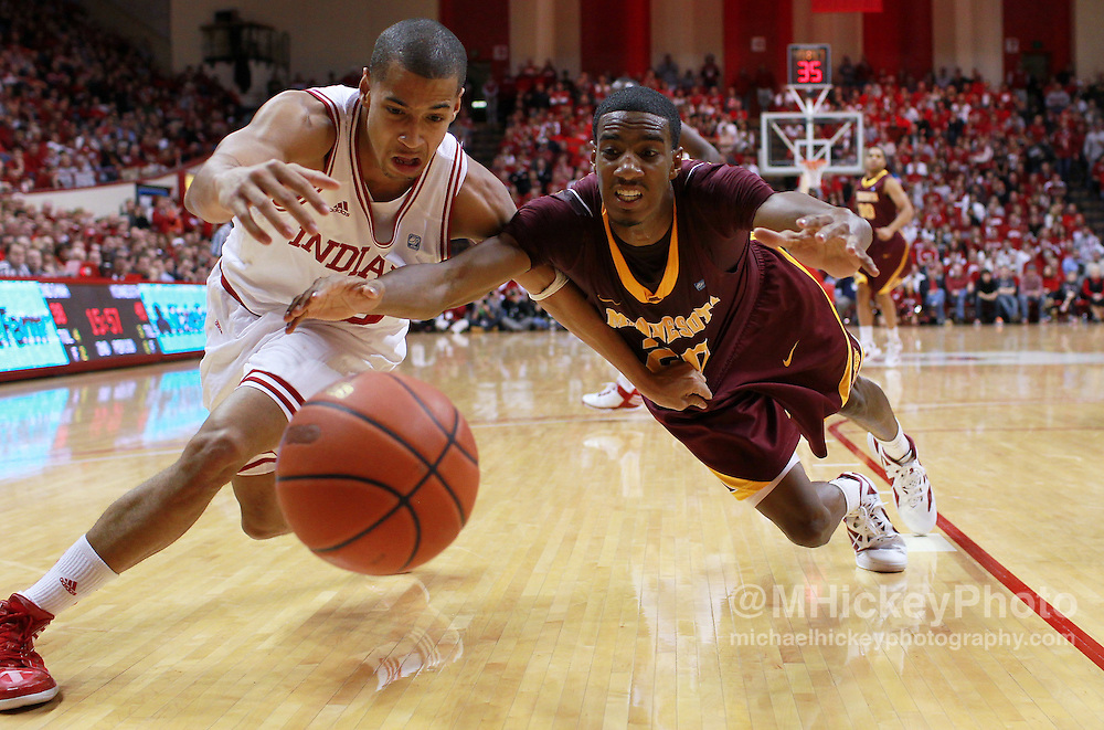 Jan. 12, 2012; Bloomington, IN, USA; Indiana Hoosiers guard Verdell Jones III (12) and Minnesota Golden Gophers guard Austin Hollins (20) scramble for a loose ball at Assembly Hall. Minnesota defeated Indiana 77-74.  Mandatory credit: Michael Hickey-US PRESSWIRE