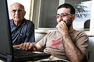 Emiliano Albensi<br /> 29/06/2013 Scanzano Jonico (MT)<br /> Nella foto: Pasquale Stigliani e suo pap&agrave; impegnati nella gestione del loro sito di e-commerce ortofrutticolo (L'Agrumeto).