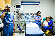 Corey Haas, 8, talks with his mother, Nancy, and a nurse before he enters surgery at the UPenn Medical Center in Philadelphia, PA on Thursday, September 25, 2008. (left) Dr. Maguire, who will be performing the surgery makes a call. Corey is sight-impaired and will undergo surgery injecting genetic material into his left eye in hopes of improving his vision.