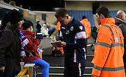 Loan signing Jed Wallace signing autograph's ahead of the Johnstone's Paint Trophy semi final first leg match between Millwall and Oxford United at The Den, London, England on 14 January 2016. Photo by Michael Hulf.