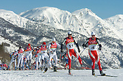 2/26/06 -- The 2006 Torino Winter Olympics -- Pragelato , Italy. -- Cross-Country Men's 50 KM -- .Competitors, headed by Norway's Frode Estil (4) and Tor Ame Hetland (11) on the course during the men's 50 km cross country race...Photo by Scott Sady, USA TODAY staff.