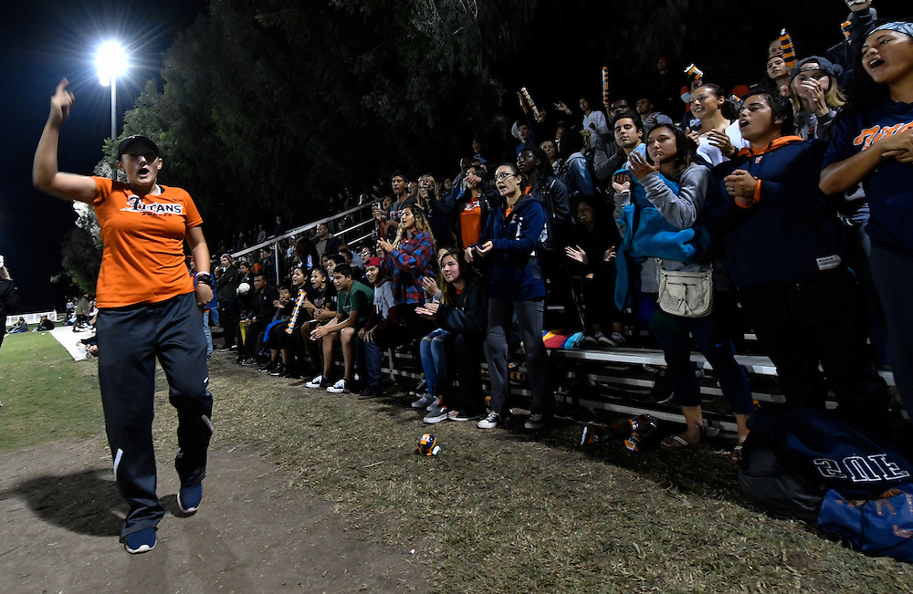 Cal State Fullerton Titans fans cheer on the women's soccer team during a Big West semi-final match against UC Irvine Friday evening at George Allen Field.