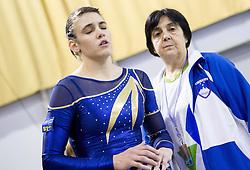 Sasa Golob of Slovenia with her coach Ljudmila Korolenko during Qualifications day of Artistic Gymnastics World Cup Ljubljana, on April 26, 2013, in Hala Tivoli, Ljubljana, Slovenia. (Photo By Vid Ponikvar / Sportida.com)