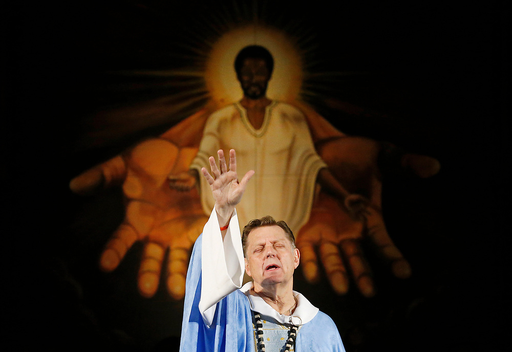 Father Michael Pfleger prays during a Sunday Service at Saint Sabina Church in Chicago, Illinois, U.S., December 4, 2016.  REUTERS/Jim Young