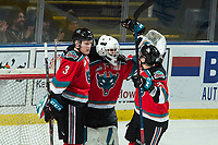 KELOWNA, CANADA - DECEMBER 7: Roman Basran #30,  Dalton Gally #3 and Lane Zablocki #27 of the Kelowna Rockets celebrate the win against the Victoria Royals on December 7, 2018 at Prospera Place in Kelowna, British Columbia, Canada.  (Photo by Marissa Baecker/Shoot the Breeze)