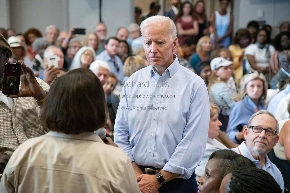 Former Vice President Joe Biden listens to a question by Felicia Sanders, during a town hall meeting at the International Longshoreman's Association Hall July 7, 2019 in Charleston, South Carolina.  Felicia Sanders was a surviver of the Emanuel AME Church shooting in 2015 where nine of her fellow worshippers were murdered by a white supremacist.
