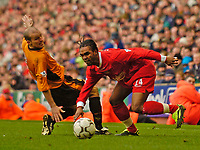 Photo. Jed Wee.<br /> Liverpool v Wolverhampton Wanderers, FA Barclaycard Premiership, Anfield, Liverpool. 20/03/2004.<br /> Liverpool's Florent Sinama-Pongolle (R) tricks his way past Wolves' Alex Rae.