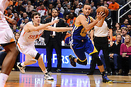 Dec 15, 2013; Phoenix, AZ, USA; Golden State Warriors guard Stephen Curry (30) drives the ball past the Phoenix Suns guard Goran Dragic (1) in the first half at US Airways Center. Mandatory Credit: Jennifer Stewart-USA TODAY Sports