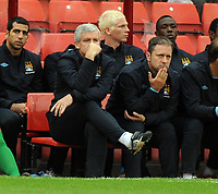 Barnsley v Manchester City  Friendly (1-1) 01/08/2009<br /> Manager Mark Hughes  looks on from the dug out  as his expensive signings struggle against lowly Barnsley<br /> Photo Roger Parker Fotosports International