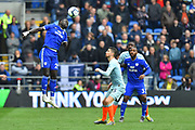 Oumar Niasse (29) of Cardiff City heads the ball during the Premier League match between Cardiff City and Chelsea at the Cardiff City Stadium, Cardiff, Wales on 31 March 2019.