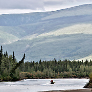 Ian Stewart/Yukon News<br /> RCMP officers search the Stewart River for Constable Michael Potvin on Monday.