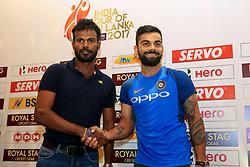 July 20, 2017 - Colombo, Sri Lanka - Sri Lankan cricket captain Upul Tharanaga(L) and Indian cricket captain Virat Kohli pose for a photograph after a press conference at Colombo, Sri Lanka on Thursday 20 July 2017...India will play 3 test matches, 5 ODI matches and a T20 match against Sri Lanka from  26 th July  onwards. (Credit Image: © Tharaka Basnayaka/NurPhoto via ZUMA Press)