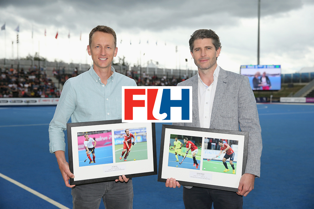 LONDON, ENGLAND - JUNE 25: Dan Fox of England and Simon Mantel of England during a presentation in the interval of the 3rd/4th place match between Malaysia and England on day nine of the Hero Hockey World League Semi-Final at Lee Valley Hockey and Tennis Centre on June 25, 2017 in London, England. (Photo by Alex Morton/Getty Images)