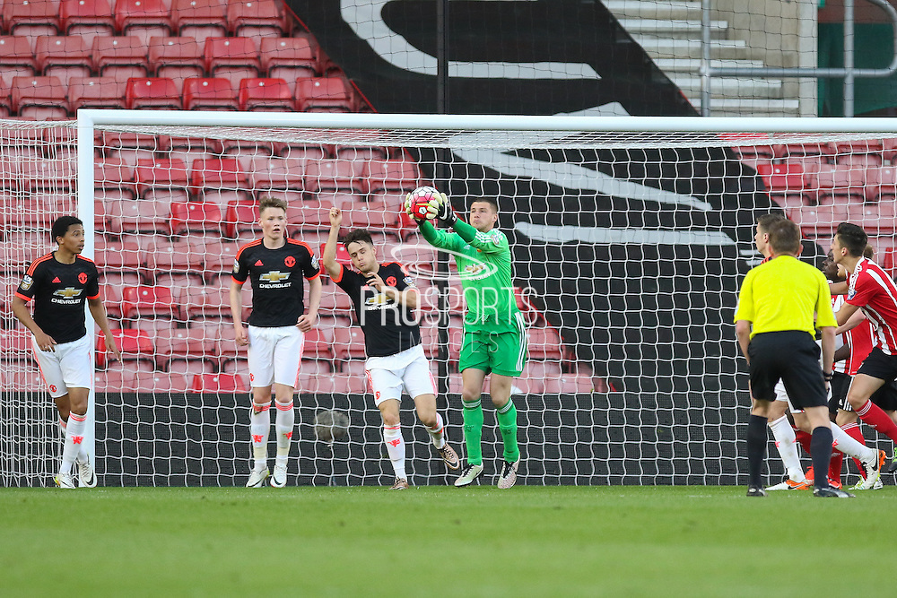 Manchester United Sam Johnstone saves and catches the ball during the Barclays U21 Premier League match between U21 Southampton and U21 Manchester United at the St Mary's Stadium, Southampton, England on 25 April 2016. Photo by Phil Duncan.