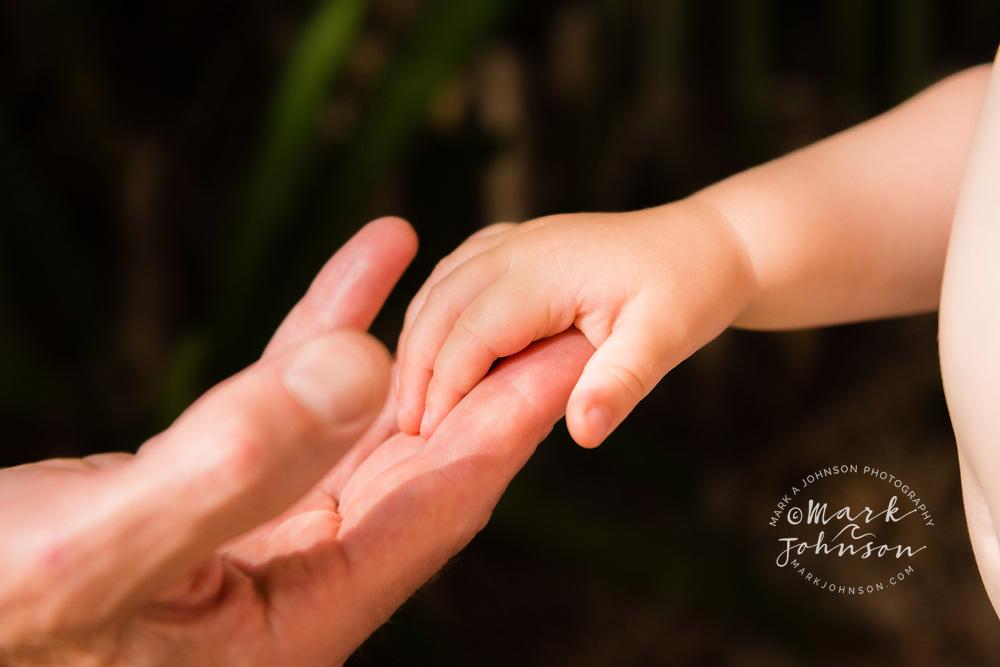 15 month old girl holding dad's hand, Caloundra, Sunshine Coast, Queensland, Australia