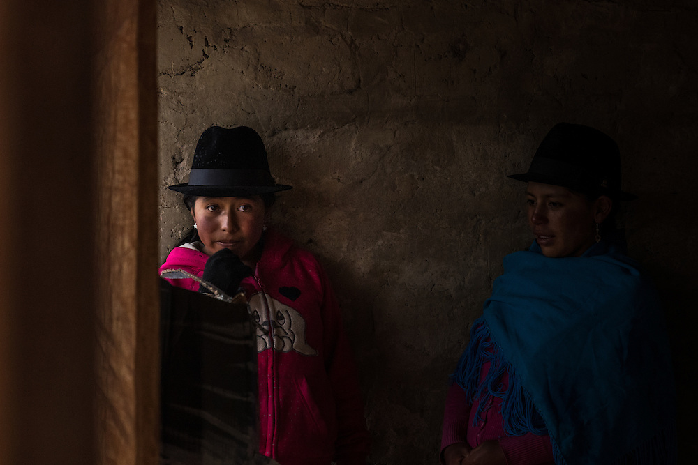 Two girsl from the highlands wearing the well known traditional hats. Every village has its own folklore that shows in their dresscode and hat. Quilotoa, Ecuador.