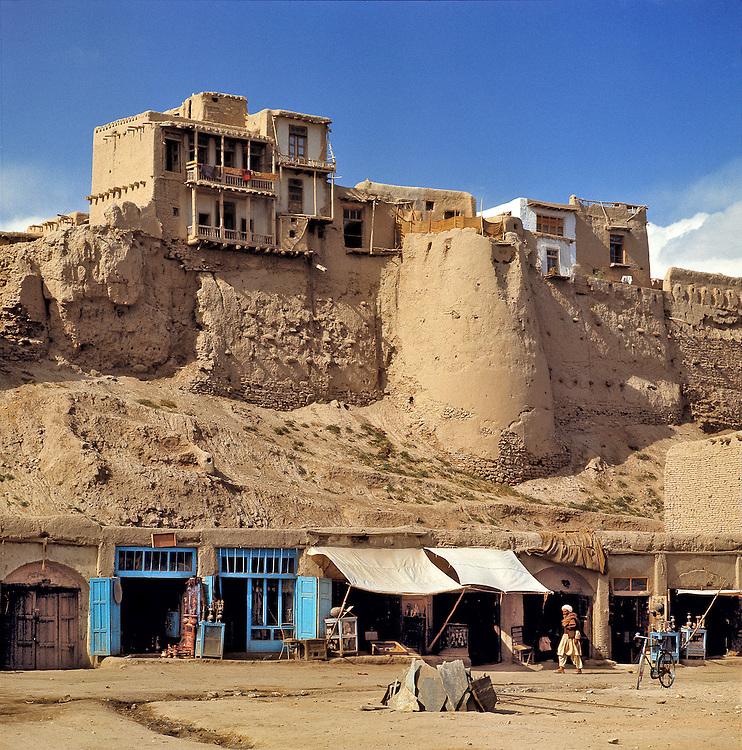 A line of merchant's stalls sit beneath the ancient wall of Ghazni, Afghanistan.