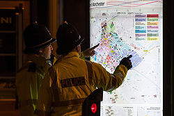 © Licensed to London News Pictures . 07/04/2017 . Manchester , UK . Police examine a map of Manchester City Centre . Greater Manchester Police have authorised dispersal powers and say they will ban people from the city centre for 48 hours , this evening (7th April 2017) , in order to tackle alcohol and spice abuse . Photo credit : Joel Goodman/LNP