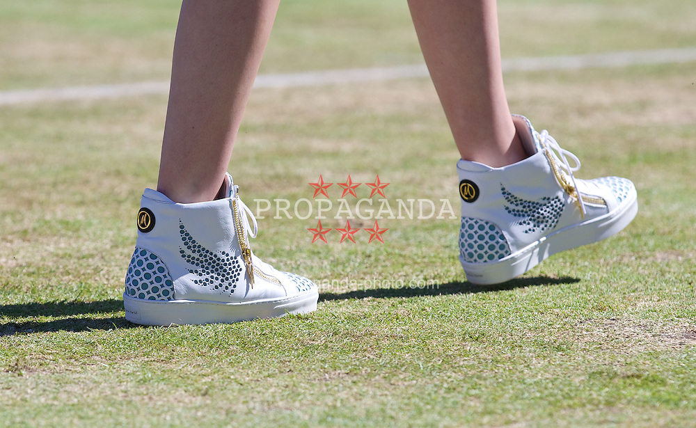 LIVERPOOL, ENGLAND - Friday, June 20, 2014: A model wearing shoes designed by Marion Bartoli during a Fashion Show during Day Two of the Liverpool Hope University International Tennis Tournament at Liverpool Cricket Club. (Pic by David Rawcliffe/Propaganda)