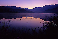 A puple sky creates a beautiful sunrise at Green Lake, Whistler, on a summer morning.