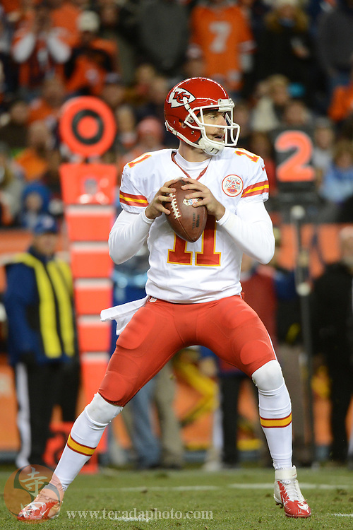 November 17, 2013; Denver, CO, USA; Kansas City Chiefs quarterback Alex Smith (11) looks for a receiver during the first quarter against the Denver Broncos at Sports Authority Field at Mile High. The Broncos defeated the Chiefs 27-17.