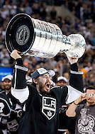 The Kings' Drew Doughty celebrates with the Stanley Cup after Los Angeles defeated the New York Rangers 3-2 in double-overtime in Game 5 of the 2014 Stanley Cup Final at Staples Center Friday.