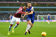 Aston Villa striker Jonathan Kodjia (26) battles for possession  with Ipswich Town midfielder (on loan from Hull City) Will Keane (14) during the EFL Sky Bet Championship match between Aston Villa and Ipswich Town at Villa Park, Birmingham, England on 26 January 2019.