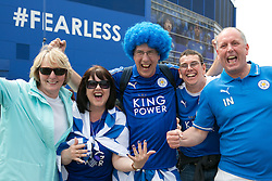 © Licensed to London News Pictures. 07/05/2016. Leicester, UK. Leicester City fans celebrating outside the King Power stadium before their match with Everton before lifting the Premiership trophy. Pictured, Painted nails and blue wig, fans celebrating. Photo credit: Dave Warren/LNP