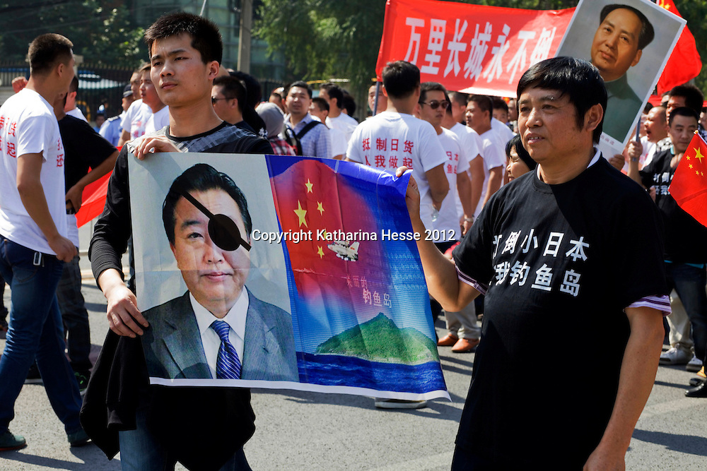 BEIJING, SEPTEMBER-16 :  Anti-Japanese protesters demonstrate over the disputed Diaoyu Islands outside the Japanese Embassy  . Protests have taken place across China in a dispute that is becoming increasingly worrying for regional stability.