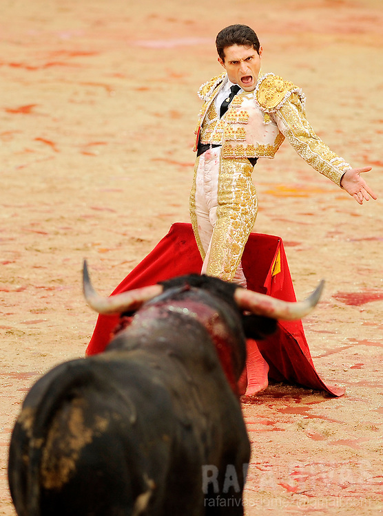 "Spanish matador ""Joselillo"" shouts at his fighting bull, on July 12, 2008, during the sixth corrida of the San Fermin festivities, in Pamplona, north of Spain."