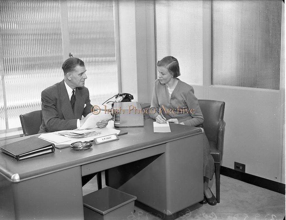 23/9/1952<br /> 9/23/1952<br /> 23 September 1952<br /> <br /> National Cash Register Mr. A.M. Davie at his desk