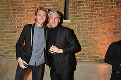 Left to right, JAMES COOK and GEORGE LAMB at the Future Contemporaries Party in association with Coach at The Serpentine Sackler Gallery, West Carriage Drive, Kensington Gardens, London on 21st February 2015.
