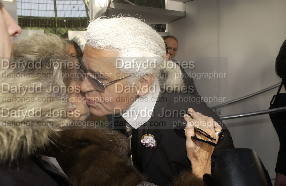 Lily Safra and Karl Largerfeld. Chanel couture fashion show. Grand Palais, Ave Winston Churchill. Paris. 24  January  2006.  ONE TIME USE ONLY - DO NOT ARCHIVE  © Copyright Photograph by Dafydd Jones 66 Stockwell Park Rd. London SW9 0DA Tel 020 7733 0108 www.dafjones.com